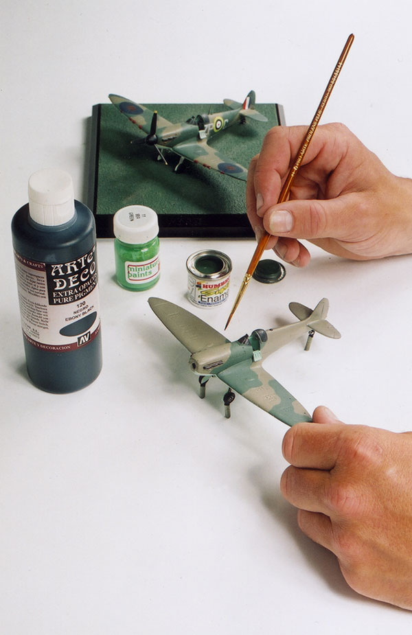 All of our aircraft and tanks are hand painted by our highly skilled painters using a combination of acrylic and enamel paints. Many of the colours for camouflage of the aircraft and tanks are mixed by ourselves and matched to authentic paint chips.