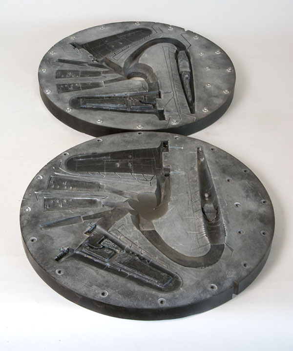 Vulcanised rubber production moulds are made for casting using the completed metal masters. Only then can the aircraft or tank model be cast in pewter.